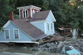 Houses were severely damaged after Hurricane Irene came through Bethel, VT. on August 28, 2011.