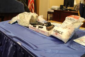 Cocaine, cash, and guns seized as part of a joint operation by the New York Attorney General's Organized Crime Task Force, New York State Police, and The Albany Police Department, are displayed for reporters.
