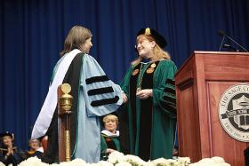 Dr. Susan Scrimshaw, president of The Sage Colleges, congratulates bestselling author Anna Quindlen as she receives an Honorary Doctorate of Humane Letters at The Sage Colleges' 95th Commencement, Saturday, May 12, 2012.