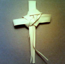 A Christian cross fashioned from palm leaves.
