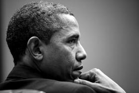 United States President Barack Obama attends a meeting in the Roosevelt Room of the White House on January 28, 2013.