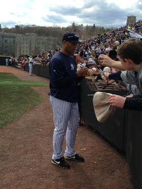 Yankees closer Mariano Rivera, who is retiring at the end of the season, signs autographs at West Point's Doubleday Field.