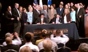Springfield Mayor Domenic Sarno ( seated at right) and MGM Springfield President Bill Hornbuckle sign the host community agreement on May 1 2013.