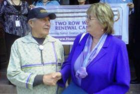 Handshake:  Oren Lyons, Onondaga Nation Faithkeeper and a Two Row Wampum expert is pictured outside Albany City Hall with Albany Common Councilmember Cathy Fahey