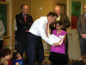 Massachusetts State Treasurer Steven Grossman congratulates first grade student Esha Zahid