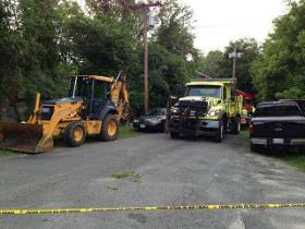 Heavy machinery at the site of the recovery efforts at the Tel-Electric dam in Pittsfield.