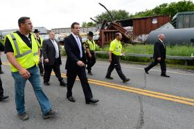 New York Governor Andrew Cuomo walks Route 5 along the CSX tracks in Montgomery County following a major freight train derailment. [June 27, 2013]