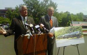 Albany Mayor Jerry Jennings with NY US Senator Chuck Schumer on the grounds of the Federal Building in Albany.