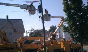 Line crews for Western Massachusetts Electric Company on Thursday ( 7/18/13) prepare to replace an old transformer in an effort to prevent power outages in Springfield's Hungry Hill neighborhood. The extreme heat is taking a toll on infrastructure.