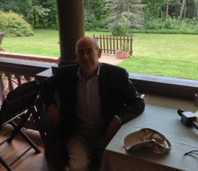 Francis Morrone sitting on the porch of Ventfort Hall where he will give a lecture on Grand Central Terminal. This year is the 100th anniversary of the terminal's opening.