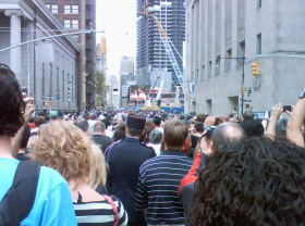 On Sunday morning 9/11/11 a crowd in Manhattan watched the Jumbotron during a solemn reading of the names of the 9/11/01 WTC victims.