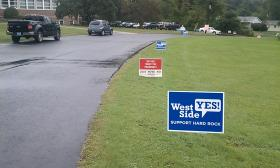 Casino campaign lawn signs on the driveway leading to a polling place in West Springfield, MA