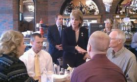 Martha Coakley chats with people at the Red Rose Pizzeria in Springfield MA as part of her barnstorming tour of the state to launch her campaign for governor.