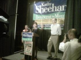 Kathy Sheehan joined by her husband and son as she gives her victory address at the Pump Station, September 10, 2013.