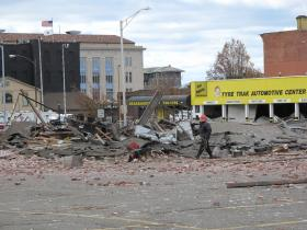 A dog searches the rubble of a building destroyed by a natural gas explosion in Springfield, MA on Nov. 23, 2012