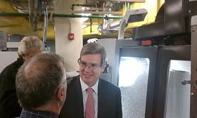 Massachusetts Economic Development Secretary Greg Bialecki tours the Mechanical Engineering Technology center at Springfield Technical Community College. The state awarded a $1.2 million grant to rehab and expand the center to double the number of students enrolled for training to work in the precision manufacturing sector.