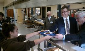 Jet Duval, a student at John F. Kennedy Middle School in Northampton, MA is served lunch by Mass.Teachers Assoc. President Paul Toner ( on left) and National Education Association President Dennis Van Roekel.  USDA Undersecretary Kevin Concannon is to the left of Toner.