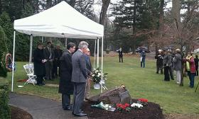 U.S. Rep. Richard Neal (foreground), Springfield Mayor Domenic Sarno and William Marot pause for a moment of reflection after places roses on the memorial stone.