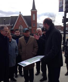 Pittsfield's Park, Open Space and Natural Resource Program Manager, Jim McGrath, on right, explains development plans for the First Street Common to Massachusetts Governor Deval Patrick, at center, along with other state and local leaders.