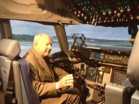 NYS Senator William Larkin inside C-17 simulator.