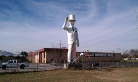 The 30-foot-tall fiberglass figure known as Plantation Man beckons to travelers exiting the Massachusetts Turnpike at Exit 6. The landmark was sold at auction on Nov. 15,2013