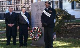 Springfield Mayor Domenic Sarno ( on left), Springfield,MA Veteran of The Year Roland Blanchard, and  Veterans Day Parade Grand Marshall Thomas Belton ( on right) placed a wreath at the Veterans' Monument in Court Square