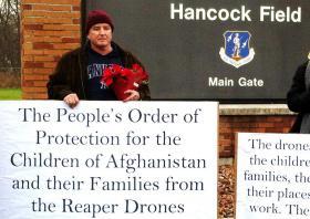 Protestors assembled Monday at Hancock AFB, Syracuse NY