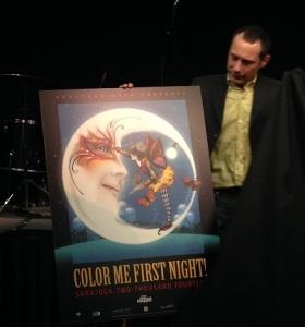 """Saratoga Arts' Executive Director Joel Reed unveils the First Night Saratoga 2014 poster. This year's theme is """"Color Me First Night""""."""