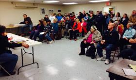 Hinsdale residents packed the meeting room and lined up down the hall at Wednesday's Select Board meeting. At the start of the meeting, Select Chair Bonnie Conner was handed a petition signed by more than 300 residents asking for her resignation.