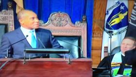 Rev. Brent Damrow listens to MA Gov. Deval Patrick's State of the Commonwealth address.