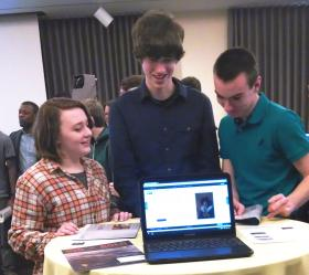 Students gather around Google Chromebooks to view the Albany Institute webpages on the Google Cultural Institute site.