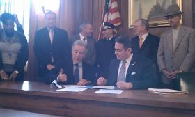 U.S. Rep. Richard Neal (D-MA)  and Springfield, MA Mayor Domenic Sarno sign papers to accept $25 million from FEMA for damage to city property from the June 1,2011 tornado