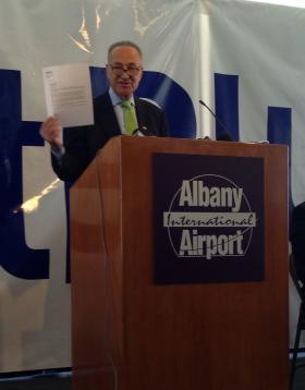 Sen. Schumer speaking Monday at Albany Airport.