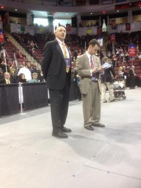Mark Fisher ( at left) stands on the floor at the state convention as votes are tallied in the balloting for governor