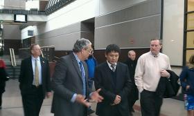 CNR-CRC President Lu Xiwei is flanked by Springfield Chief Development Officer Kevin Kennedy ( at  right) and Putnam Vocational Technical High School Principal Gilbert Traverso. The school would be part of a program to train workers for the rail car factory Lu's company is considering building in Springfield