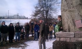 William O'Riordan,former Hampshire chief probation officer, speaks in front of the stone memorial to Dominic Daley and James Halligan. The two Irish immigrants were hanged in Northampton,MA in 1806 for a murder they did not commit.