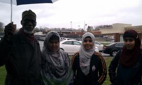 Kamal Ali of the Islamic Society of Western Massachusetts with ( l to r) Filsan Hussein,Najma Hussein, and Hibo Hussein  outside West Springfield High School