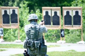 A New York Army National Guard Soldier engages targets during the May 2013 Adjutant General's Match at Camp Smith.
