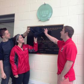 Hoosac Valley seniors unveil the LEED Gold Certification plaque in the school's atrium. From left to right: Conor Wotkowicz, Renee Vittone and Ian Hill.