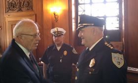 Hampden County Sheriff Michael Ashe ( at left) seen here congratulating Springfield Police Commissioner William Fitchet on his recent retirement was honored at the White House for pioneering programs to help former inmates re-enter society