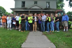 Ribbon-cutting ceremony for renovations to Private Dan Flanigan's home