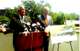 Then-Albany Mayor Jerry Jennings with NY US Senator Chuck Schumer on the grounds of the Federal Building in Albany. (July 2013).