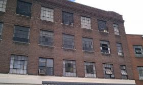 Authorities in Springfield, MA allege an illegal nightclub was being operated in space rented on the third floor of this old factory building on South Main Street.