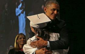 President Obama hugs a graduate of Worcester Technical High School during the commencement for the class of 2014