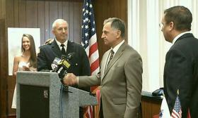 Chicopee Police Chief William Jebb shakes hands with Mayor Richard Kos following the mayor's announcement that he had promoted Jebb to head the police department.