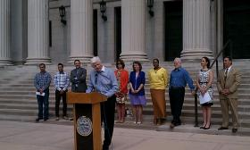 Organizers of the Springfield Unity Festival announce details of the event in front of Symphony Hall. The co-founder York Mayo is at the microphone