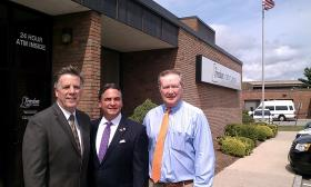 Standing in front of the Freedom Credit Union headquarters on Main Street in Springfield are ( l to r) CEO Barry Crosby, Springfield Mayor Domenic Sarno, Springfield Chief Development Officer Kevin Kennedy