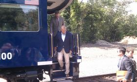 Gov. Deval Patrick steps off a train in Greenfield to announce an agreement in principle to purchase a refurbished north-south rail line from Pan Am Southern