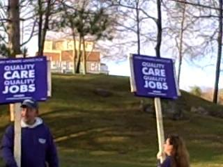 Workers in front of the hospital in North Adams