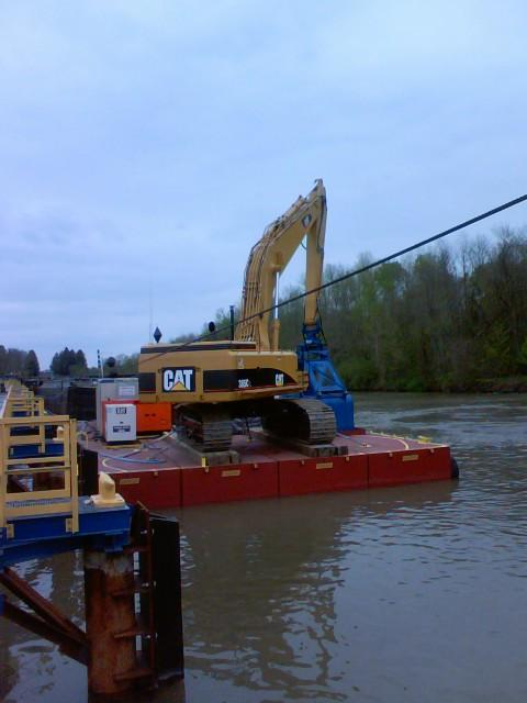 Dredging equipment positioned along the Hudson River at Ft. Edward.